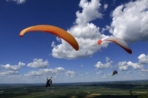 Tandem paragliders on a sunny day