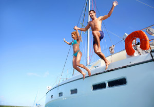 bigstock-Young-couple-jumping-in-water-40349452-копия